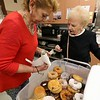 Josephine Cormier is a volunteer at the Fitchburg Senior Center. On Wednesday during a break in Bingo she got donuts for the players. Joanne Malloy picks out a donut from Cormier's selection. SENTINEL & ENTERPRISE/JOHN LOV