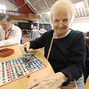 Josephine Cormier is a volunteer at the Fitchburg Senior Center. On Wednesday during a break in Bingo she got donuts for the players. After volunteering on Wednesday mornings Cormier likes to play Bingo. SENTINEL & ENTERPRISE/JOHN LOVE