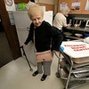 Josephine Cormier is a volunteer at the Fitchburg Senior Center. On Wednesday during a break in Bingo she got donuts for the players. SENTINEL & ENTERPRISE/JOHN LOVE