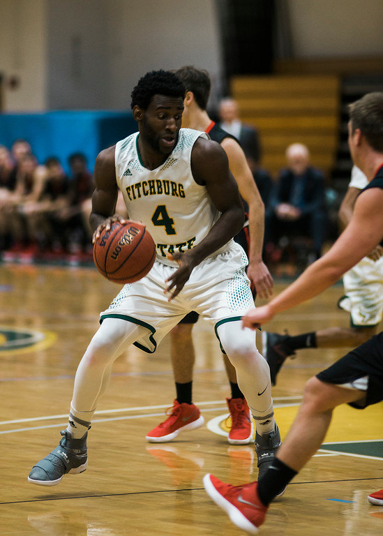 . Fitchburg State\'s Anslem Edegbe  in action during the game against Clark on Tuesday, December 5, 2017. SENTINEL & ENTERPRISE / Ashley Green