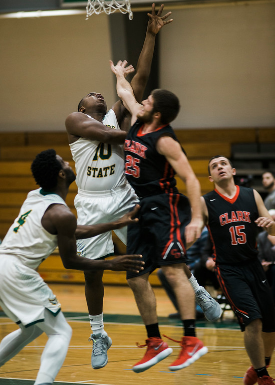 . Fitchburg State\'s Tyrell St. John in action during the game against Clark on Tuesday, December 5, 2017. SENTINEL & ENTERPRISE / Ashley Green