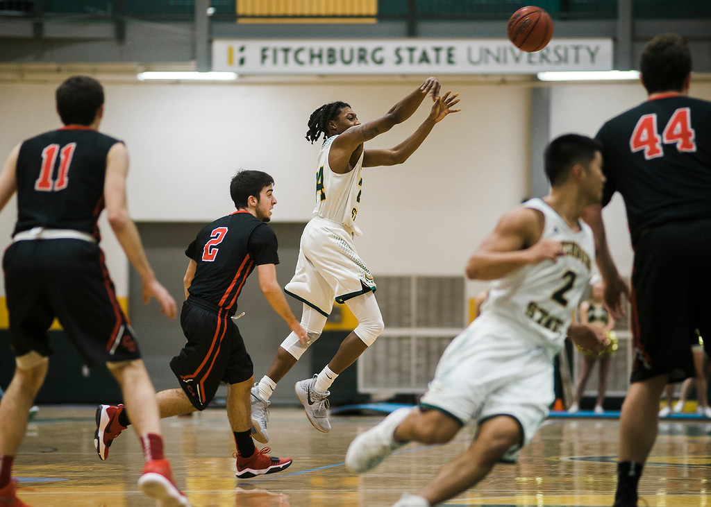 . Fitchburg State\'s Nicholas Tracy in action during the game against Clark on Tuesday, December 5, 2017. SENTINEL & ENTERPRISE / Ashley Green