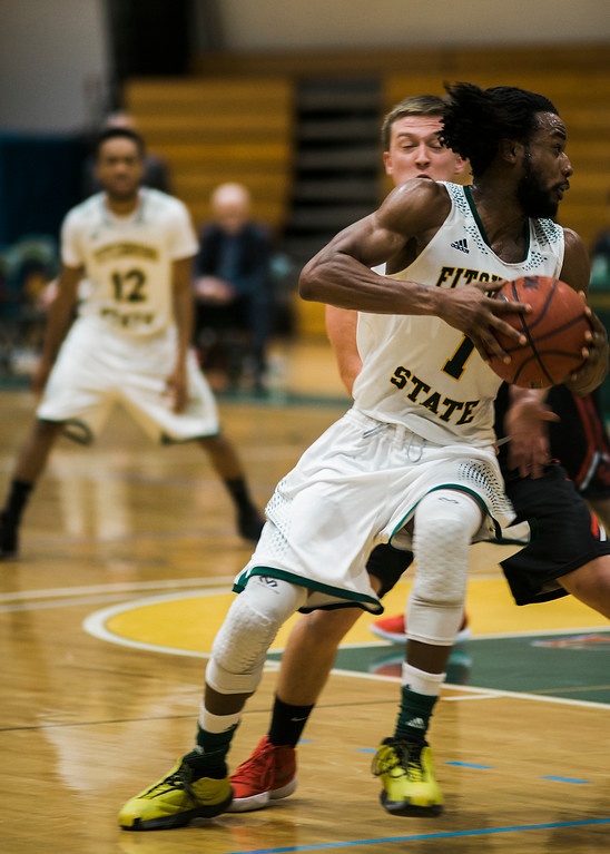. Fitchburg State\'s Jerrell Gomes in action during the game against Clark on Tuesday, December 5, 2017. SENTINEL & ENTERPRISE / Ashley Green
