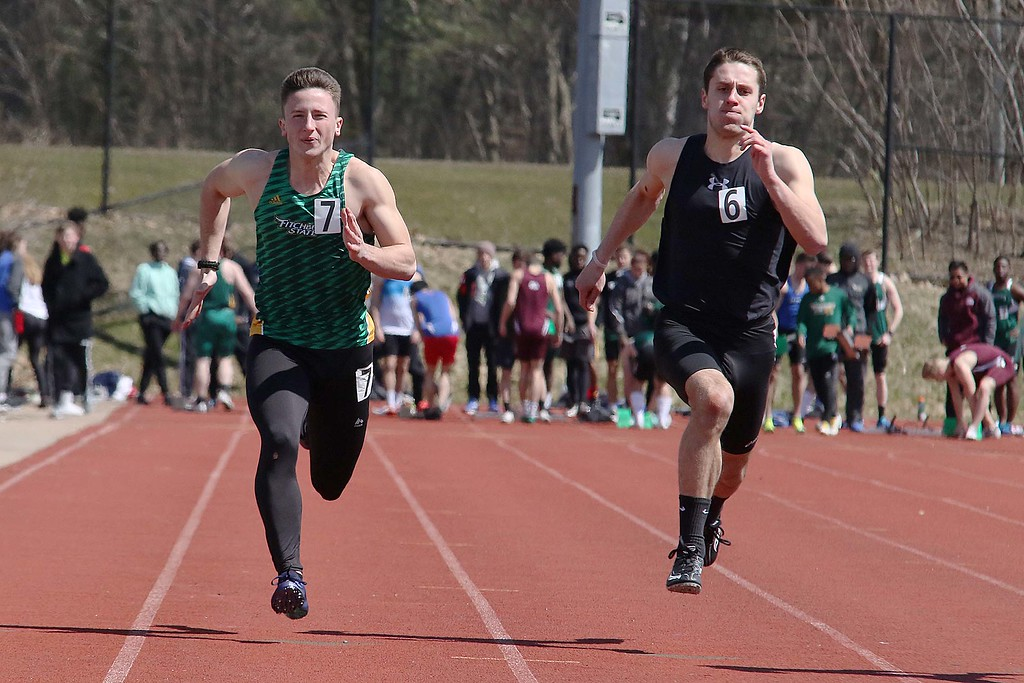 . Track meet at Fitchburg State University on Saturday, April 7, 2018. Running in the 100 meter is FSU freshman Brandon Amello from Rowley. SENTINEL & ENTERPRISE/JOHN LOVE