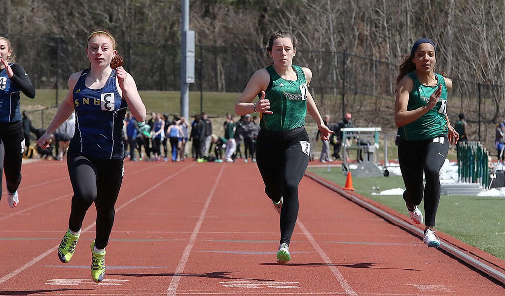. Track meet at Fitchburg State University on Saturday, April 7, 2018. Running in the 100 meter is FSU senior Amanda Remie, center, from Barnstable and FSU senior Angelica Beato, on right, from Lowell. SENTINEL & ENTERPRISE/JOHN LOVE