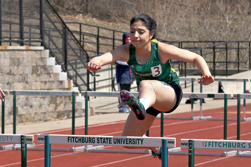 . Track meet at Fitchburg State University on Saturday, April 7, 2018. Running in the 100 meter hurdles is FSU freshman Makaisha Gonzalez. SENTINEL & ENTERPRISE/JOHN LOVE