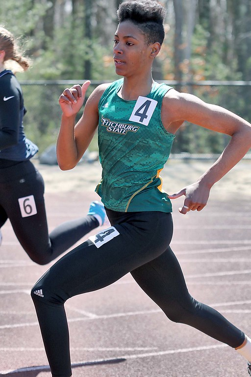 . Track meet at Fitchburg State University on Saturday, April 7, 2018. Running in the 400 is FSU senior Annie Woolley. SENTINEL & ENTERPRISE/JOHN LOVE