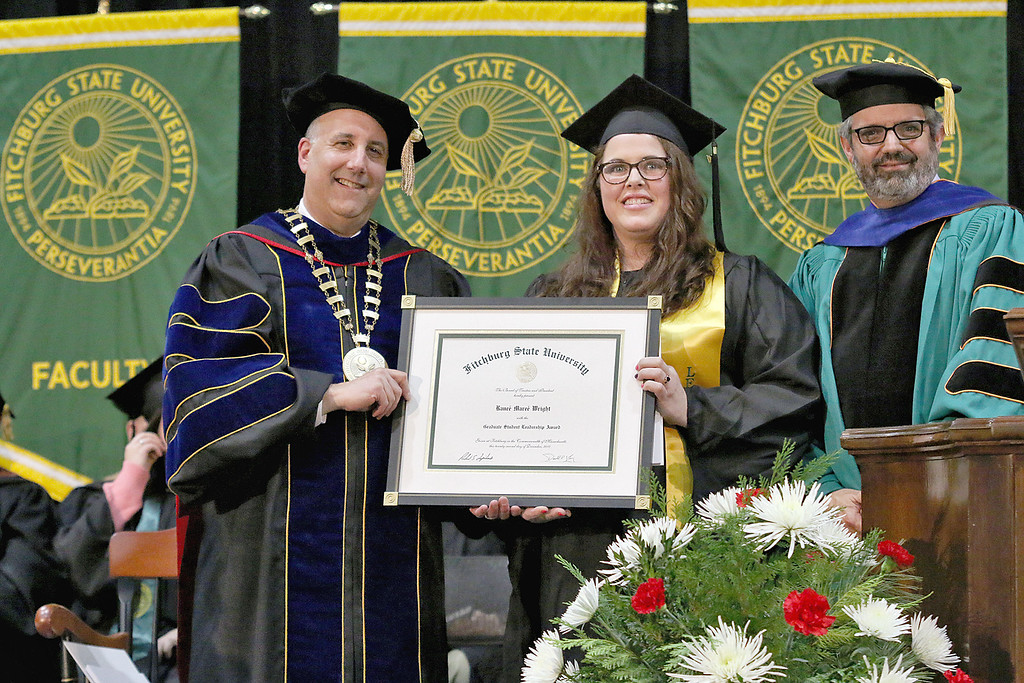 . Ranee Maree Wright receives the graduate student leadership award from President Richard Lapidus, on left, and Provost and Vice President of Fitchburg State University Dr. Alberto Cardelle at the Fitchburg State University 121 Annual Commencement on Friday December 22, 2017. SENTINEL & ENTERPRISE/JOHN LOVE