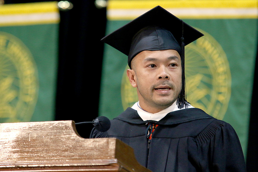 . Newly sworn in State Senator Dean A. Tran addresses the graduates at the Fitchburg State University 121 Annual Commencement on Friday December 22, 2017. SENTINEL & ENTERPRISE/JOHN LOVE
