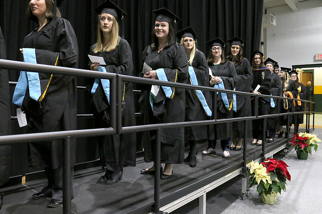 . Graduates line up to get their diplomas at the Fitchburg State University 121 Annual Commencement on Friday December 22, 2017. SENTINEL & ENTERPRISE/JOHN LOVE