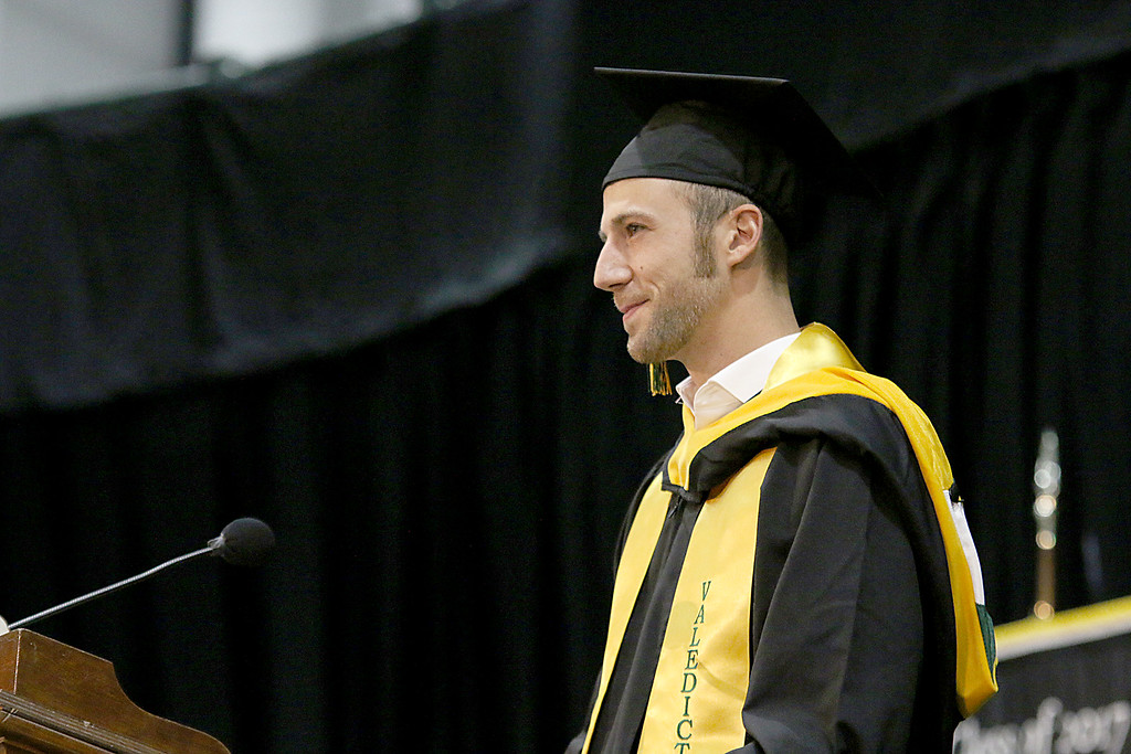 . Fitchburg State University Valedictorian Alexander Steacy addresses his classmates at the Fitchburg State University 121 Annual Commencement on Friday December 22, 2017. SENTINEL & ENTERPRISE/JOHN LOVE