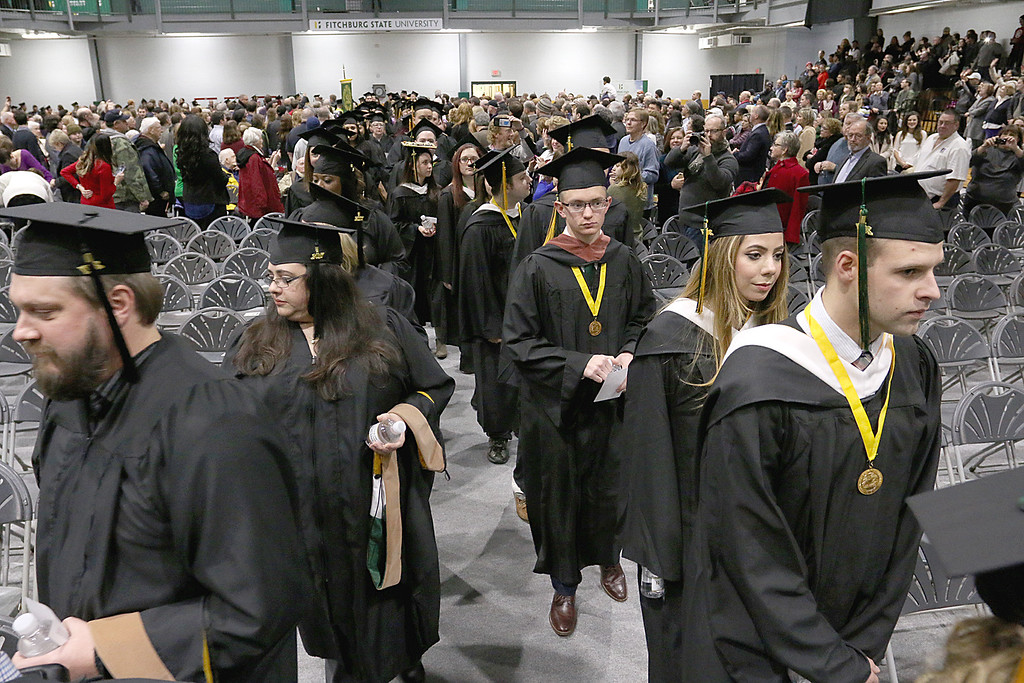 . Fitchburg State University graduates march into the gym at the Athletics and Recreation Center to start the 121 annual commencements on Friday December 22, 2017. SENTINEL & ENTERPRISE/JOHN LOVE