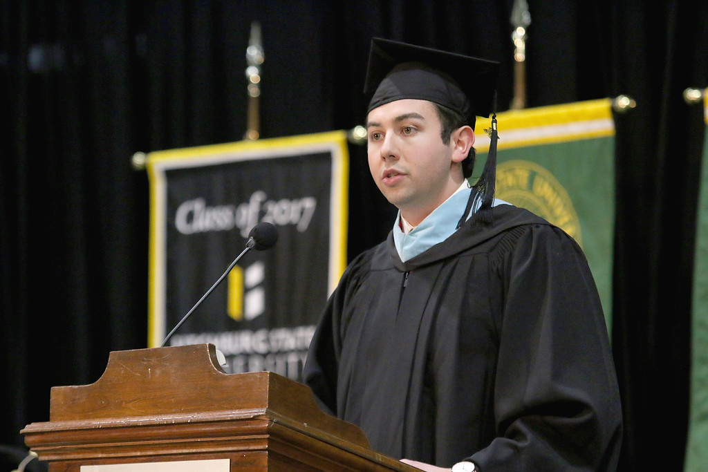 . Eric Gregoire of the class of 2011 and the president of the Alumni Association addresses the graduates at the 121 annual commencements on Friday December 22, 2017. SENTINEL & ENTERPRISE/JOHN LOVE