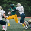 Fitchburg State's Jevon Brown-Simpson runs the ball during the game against Mass Maritime on Saturday afternoon. SENTINEL & ENTERPRISE / Ashley Green