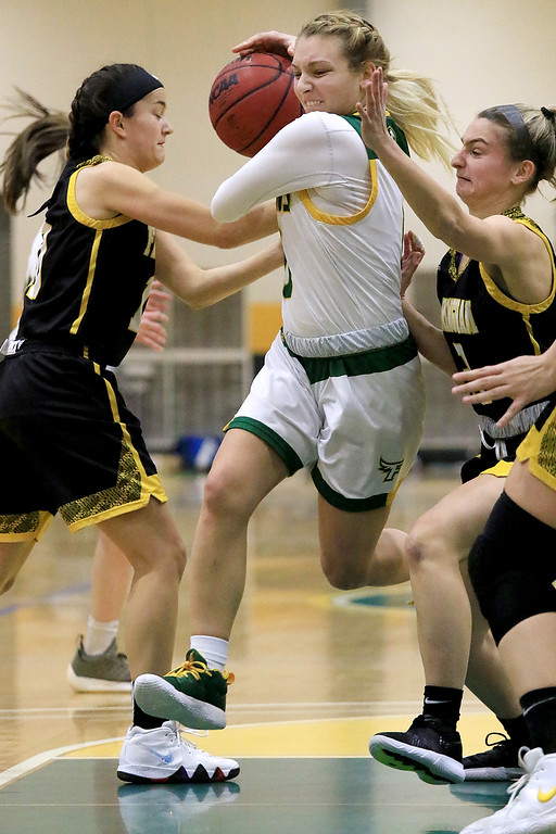 . Fitchburg State University ladies basketball played Framingham State University on Saturday, January 26, 2019 at Fitchburg State\'s Recreation Center. Fitchburg\'s Angelina Marazzi dribbles past two Framingham players as she drive to the basket. Framingham State won, 90-63. SENTINEL & ENTERPRISE/JOHN LOVE