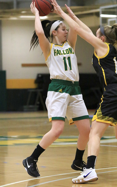 . Fitchburg State University ladies basketball played Framingham State University on Saturday, January 26, 2019 at Fitchburg State\'s Recreation Center. Fitchburg\'s Payton Holmes tries to find a teammate to pass to pass to while being guarded by a Framingham player. SENTINEL & ENTERPRISE/JOHN LOVE