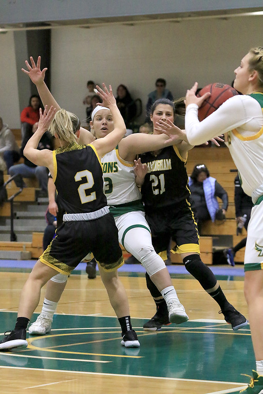 . Fitchburg State University ladies basketball played Framingham State University on Saturday, January 26, 2019 at Fitchburg State\'s Recreation Center. Fitchburg\'s Emily Beauvais looks for an inbound pass while being guarded by Framingham\'s Liana Cunningham and Tiphani Harris. SENTINEL & ENTERPRISE/JOHN LOVE