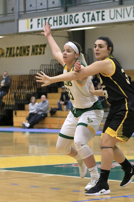 . Fitchburg State University ladies basketball played Framingham State University on Saturday, January 26, 2019 at Fitchburg State\'s Recreation Center. Fitchburg\'s Emily Beauvais and Framingham\'s Mallory DeFeo fight for position under the net during action in the first quarter. SENTINEL & ENTERPRISE/JOHN LOVE