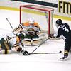FSU's Josh Victor helps block the shot of Joe Flanagan on goalie Charles Jakobsson