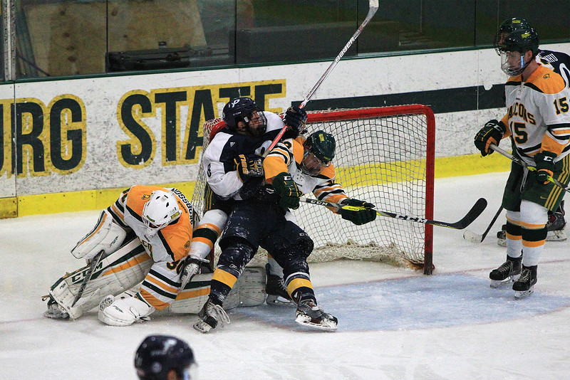 FSU Goalie Charles Jakobsson ties the puck up as FSU's James Gordon hits Joseph Berardi in the crease of the net during Fitchburg State's season-opening 5-2 loss at the Wallace Civic Center in Fitchburg on Friday, Oct. 28, 2016. SENTINEL & ENTERPRISE / SCOTT LAPRADE