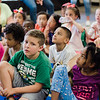 Students listen in as Native American storyteller Larry Spotted Crow Mann tells stories at Fitchburg Public Schools' Journeys Summer Camp to celebrate the opening of camp on Thursday, July 6, 2017. Mann is a member of the Nipmuc Tribe of Central Mass. and is a writer, poet, cultural educator, tribal drummer, dancer and traditional storyteller. SENTINEL & ENTERPRISE / Ashley Green