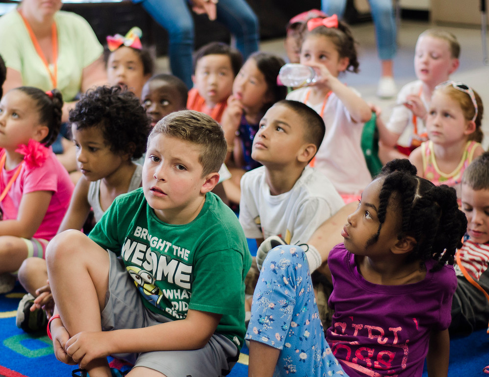 . Students listen in as Native American storyteller Larry Spotted Crow Mann tells stories at Fitchburg Public Schools� Journeys Summer Camp to celebrate the opening of camp on Thursday, July 6, 2017. Mann is a member of the Nipmuc Tribe of Central Mass. and is a writer, poet, cultural educator, tribal drummer, dancer and traditional storyteller. SENTINEL & ENTERPRISE / Ashley Green