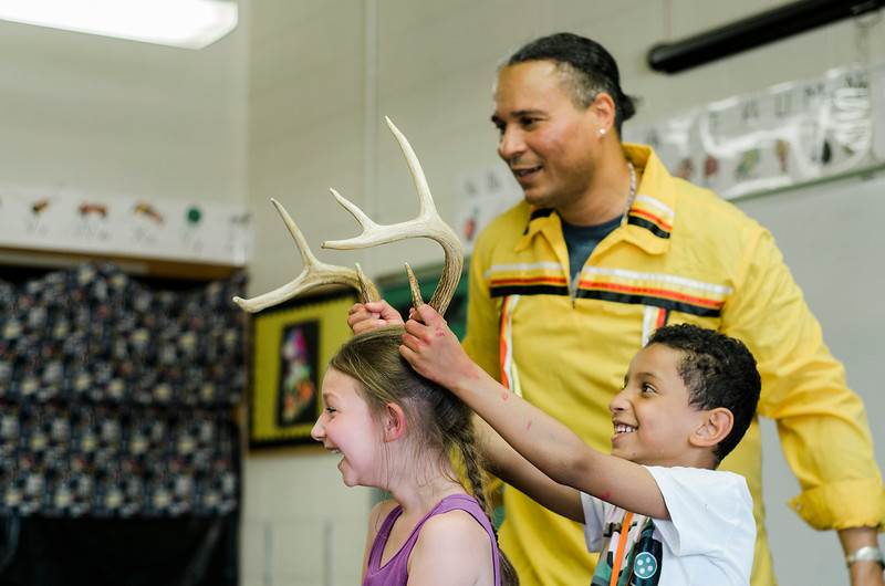 Angelo Ortiz and Phoenix Morrisette act in a skit with Native American storyteller Larry Spotted Crow Mann at Fitchburg Public Schools' Journeys Summer Camp to celebrate the opening of camp on Thursday, July 6, 2017. Mann is a member of the Nipmuc Tribe of Central Mass. and is a writer, poet, cultural educator, tribal drummer, dancer and traditional storyteller. SENTINEL & ENTERPRISE / Ashley Green