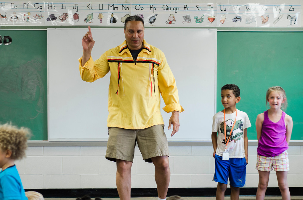 . Native American storyteller Larry Spotted Crow Mann tells stories at Fitchburg Public Schools� Journeys Summer Camp to celebrate the opening of camp on Thursday, July 6, 2017. Mann is a member of the Nipmuc Tribe of Central Mass. and is a writer, poet, cultural educator, tribal drummer, dancer and traditional storyteller. SENTINEL & ENTERPRISE / Ashley Green