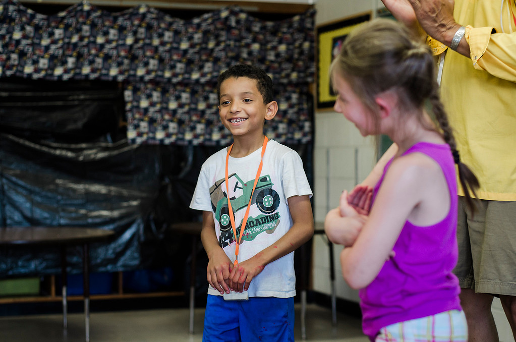. Angelo Ortiz and Phoenix Morrisette act in a skit with Native American storyteller Larry Spotted Crow Mann at Fitchburg Public Schools� Journeys Summer Camp to celebrate the opening of camp on Thursday, July 6, 2017. Mann is a member of the Nipmuc Tribe of Central Mass. and is a writer, poet, cultural educator, tribal drummer, dancer and traditional storyteller. SENTINEL & ENTERPRISE / Ashley Green