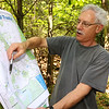 Ralph Baker talks about the trails in Fitchburg as he hold a trail map.  SENTINEL & ENTERPRISE/JOHN LOVE