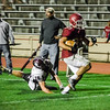 Fitchburg's Alex Marrero breaks through the grip of Groton Dunstable's Mitchell Townsend during the game on Friday evening at Crocker Field. SENTINEL & ENTERPRISE / Ashley Green