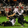 Groton Dunstable defense brings down Fitchburg's Alex Marrero during the game on Friday evening at Crocker Field. SENTINEL & ENTERPRISE / Ashley Green