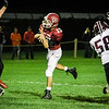 Fitchburg's Andrew Brooks gets rid of the ball during the game against Groton Dunstable on Friday evening at Crocker Field. SENTINEL & ENTERPRISE / Ashley Green