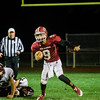 Fitchburg's Devin DeLeon runs the ball during the game against Groton Dunstable on Friday evening at Crocker Field. SENTINEL & ENTERPRISE / Ashley Green
