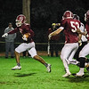 Fitchburg's CJ Byars breaks away for a touchdown run during the game against Groton Dunstable on Friday evening at Crocker Field. SENTINEL & ENTERPRISE / Ashley Green