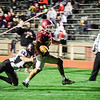 Fitchburg's Alex Marrero breaks through the grip of Groton Dunstable's Justin Griffin during the game on Friday evening at Crocker Field. SENTINEL & ENTERPRISE / Ashley Green