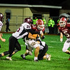 Fitchburg's Alex Marrero breaks through the defense during the game against Groton Dunstable on Friday evening at Crocker Field. SENTINEL & ENTERPRISE / Ashley Green