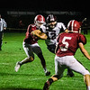 Fitchburg's CJ Byars chases down Groton Dunstable's Michael Tammaro during the game on Friday evening at Crocker Field. SENTINEL & ENTERPRISE / Ashley Green