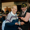 Vietnam Veteran Mary Plummer is presented with a pin and certificate during Fitchburg's Veterans Day ceremony on Friday morning at the Senior Center. SENTINEL & ENTERPRISE / Ashley Green