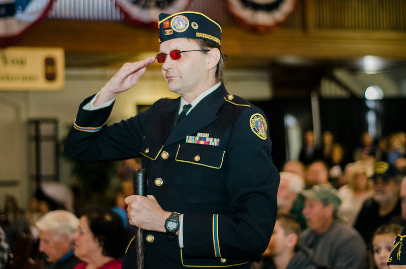 """Navy Veteran J. Turpin salutes during the """"Salute to America's Finest"""" at Fitchburg's Veterans Day ceremony on Friday morning. SENTINEL & ENTERPRISE / Ashley Green"""
