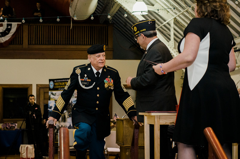 Vietnam Veteran George LeBlanc is presented with a pin and certificate during Fitchburg's Veterans Day ceremony on Friday morning at the Senior Center. SENTINEL & ENTERPRISE / Ashley Green