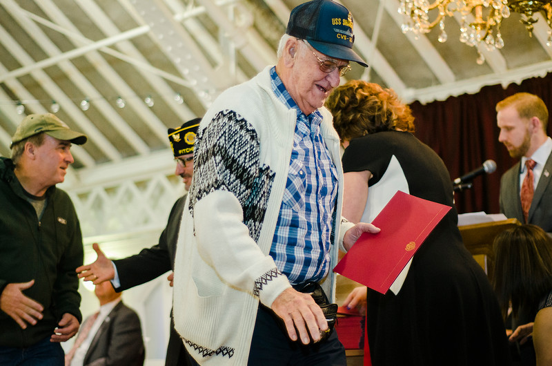 Vietnam Veteran Daniel DeLorme is presented with a pin and certificate during Fitchburg's Veterans Day ceremony on Friday morning at the Senior Center. SENTINEL & ENTERPRISE / Ashley Green