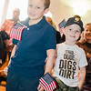 Cub Scouts Trevor Kidd, 6, and Matthe LeFrancois, 5, show off their patriotism at Fitchburg's Veterans Day ceremony on Friday morning. SENTINEL & ENTERPRISE / Ashley Green