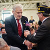 Vietnam Veteran Raimo Ahti is presented with a pin and certificate during Fitchburg's Veterans Day ceremony on Friday morning at the Senior Center. SENTINEL & ENTERPRISE / Ashley Green