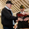 Vietnam Veteran Louis Dufresne is presented with a pin and certificate during Fitchburg's Veterans Day ceremony on Friday morning at the Senior Center. SENTINEL & ENTERPRISE / Ashley Green