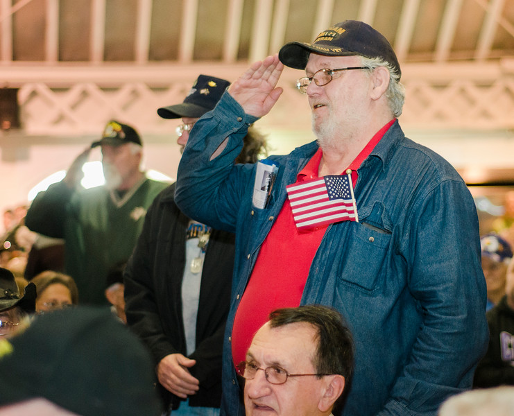 """Veterans stand during the """"Salute to America's Finest"""" at Fitchburg's Veterans Day ceremony on Friday morning. SENTINEL & ENTERPRISE / Ashley Green"""