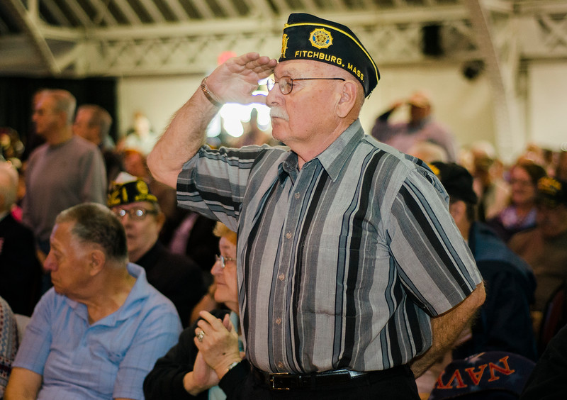 """Navy Veteran Norman Mezzanotti salutes during the """"Salute to America's Finest"""" at Fitchburg's Veterans Day ceremony on Friday morning. SENTINEL & ENTERPRISE / Ashley Green"""