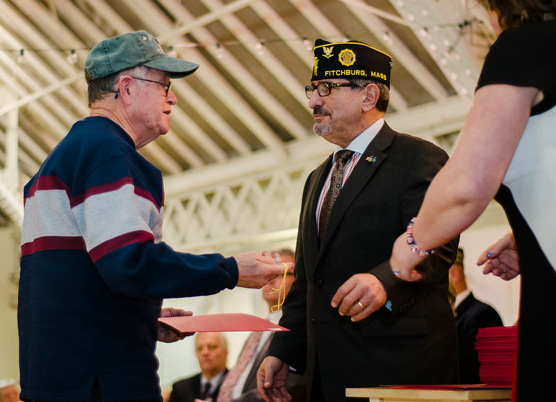 Vietnam Veteran Harry Bellabarba, Jr. is presented with a pin and certificate during Fitchburg's Veterans Day ceremony on Friday morning at the Senior Center. SENTINEL & ENTERPRISE / Ashley Green