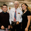 Tai Le and Alydiah Le pose for a photo with their grandfather, Navy veteran Fred Cuddy following Fitchburg's Veterans Day ceremony on Friday morning at the Senior Center. SENTINEL & ENTERPRISE / Ashley Green