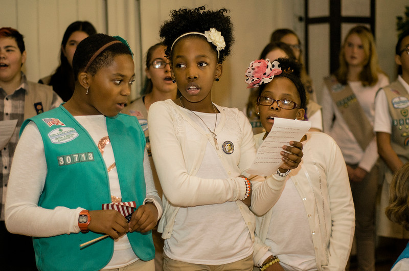 Girl Scouts Alexiss Edmonds, Adonijah Copeland and Jazzaniah Copeland perform during Fitchburg's Veterans Day ceremony on Friday morning at the Senior Center. SENTINEL & ENTERPRISE / Ashley Green